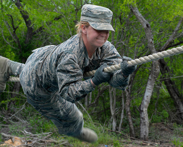 Airman on horizontal rope obstacle