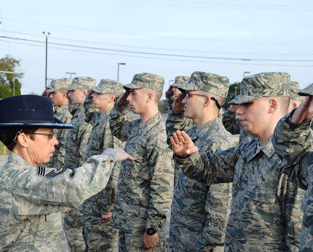 Trainees learning to salute