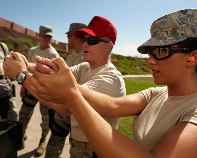 Airmen learning handgun safety
