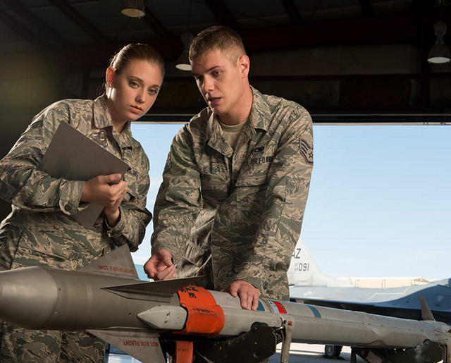 Airmen with munitions