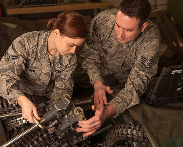 Airmen with parts